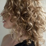 Side-View-of-Shoulder-Length-Soft-Curly-Hairstyle-for-One-Shoulder-Bress