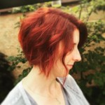 Redhead-short-red-messy-curly-angled-bob-hairstyle