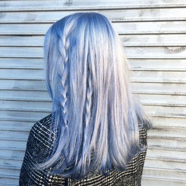 Silver-hair-with-pastel-blue-color-adding-blue-and-side-braids-make-this-color-look-more-cute-