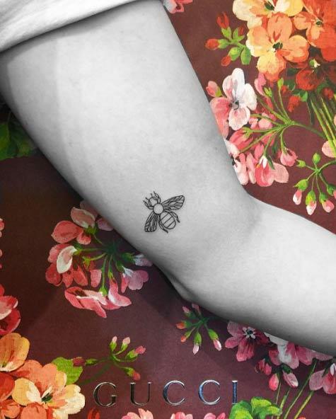 tiny-girl-tattoo-design-95
