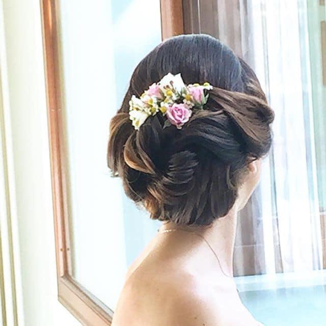 acconciatura sposa fiori
